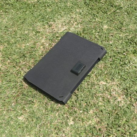 SunSaver Ultra-Flex portable solar charger closed on grass