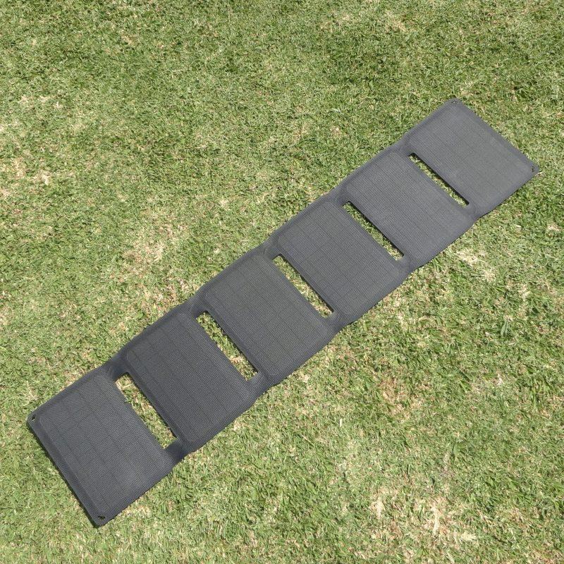 SunSaver Ultra-Flex portable solar charger open on grass